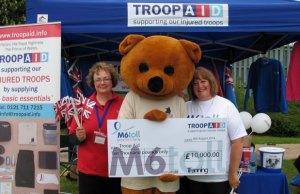 The M6 Toll cheque being handed over to Troop Aid