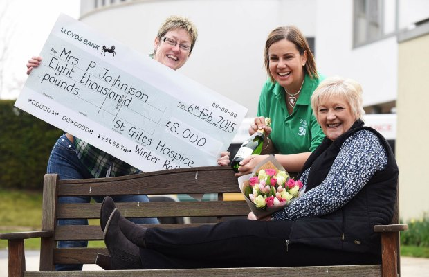 Lesley Holmes (Lottery Development Manager, St Giles Hospice), Alison Jerram (Lottery Manager, St Giles Hospice) and previous raffle winner Jane Johnson