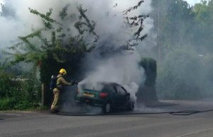 A firefighter tackles the blaze this morning. Pic: Nigel Storr