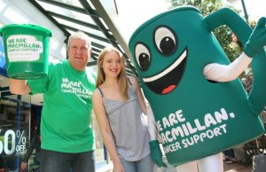 Emma-Kate Rowley of the Three Spires Shopping Centre with fundraiser Ian Draper and Macmillan Cancer Support Mascot Muggy