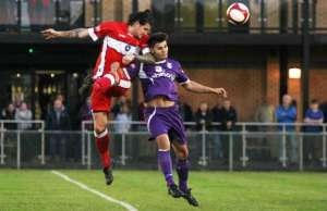 James Dance wins the ball in the air. Pic: Dave Birt