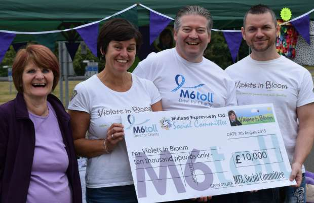 Janet Cox, Kerry Mornington, Andy Pearson and Ivan Mornington with the Violets in Bloom cheque
