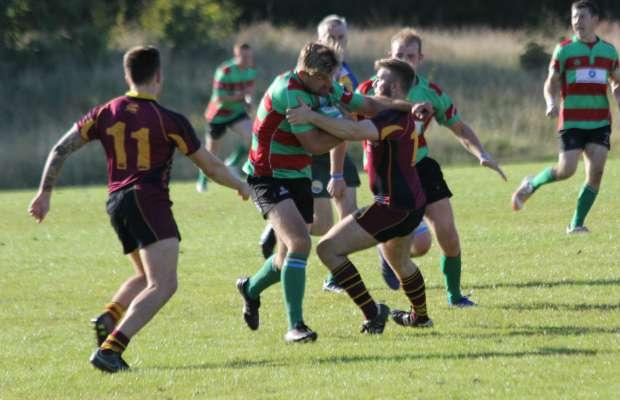 Graham Shelley tries to burst through a tackle. Pic: Joanne Gough