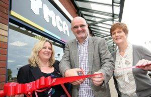 Pamela Rose, Andy Horsnail and Julie Mees of YMCA open the charity's new shop at Three Spires Shopping Centre