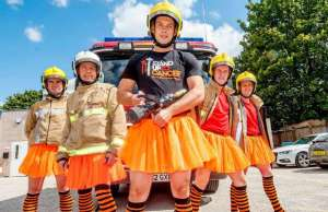 Firefighters of Red Watch from Lichfield fire station strike a pose in orange tutus and striped tights to highlight the 'Crazy Legs' challenge for Stand Up To Cancer