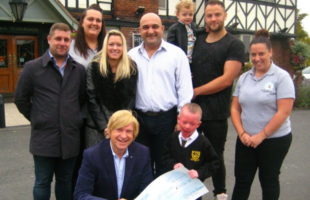 Michael Fabricant MP hands over the fundraising cheque from Lichfield Rocks