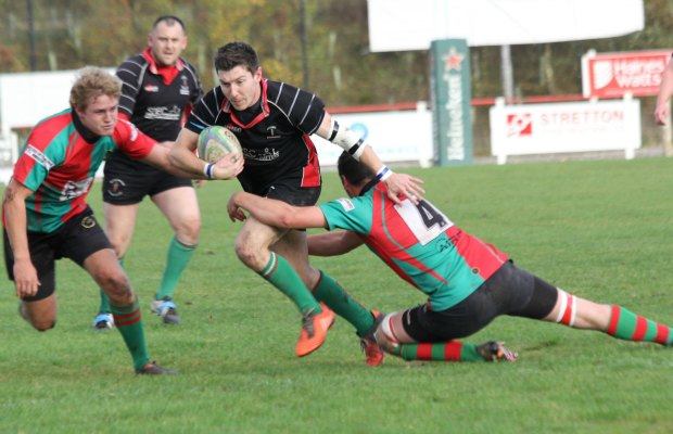 Ben Holt tries to burst through a tackle. Pic: Joanne Gough
