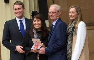 Marg Randles celebrates her OBE with members of her family
