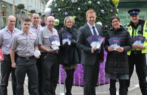 Mark Walpole, Tom Hyde, Chris Ward and Steve Whitehouse from Staffordshire Fire & Rescue Service, Julia Woodward from Three Spires Shopping Centre, Cllr Doug Pullen, Lichfield District Council's community safety officer Lucie Ferneyhough and PCSO Sam Russell launch the new safety calendar