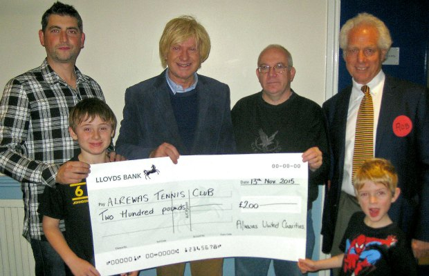 Michael Fabricant MP handing over a cheque to Alrewas Tennis Club