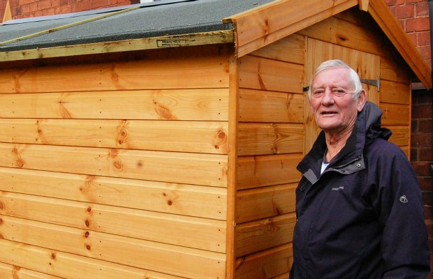 Cllr Eric Drinkwater with the new shed at the Old Mining College Centre
