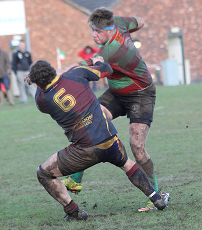 Sean Latham tries to break through a tackle. Pic: Joanne Gough