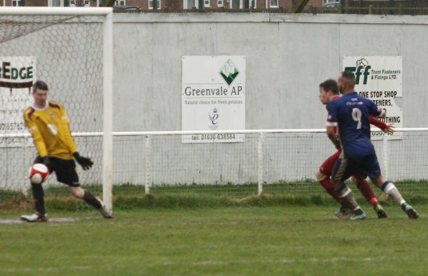 The Market Drayton keeper sees George Washbourne's shot skid past him. Pic: Dave Birt