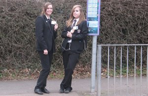 Teenagers Francesca and Amy with their Your Staffordfshire Cards
