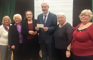 Members of Chasetown Women's Guild hand over their fundraising cheque