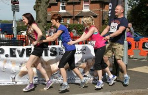 Competitors conga their way round the world's shortest fun run course
