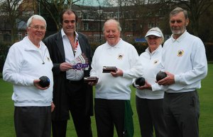 Bernard Derrick, Simon Price, Geoffrey Parkinson, Janet Holland and Peter Holland celebrating the continued sponsorship agreement