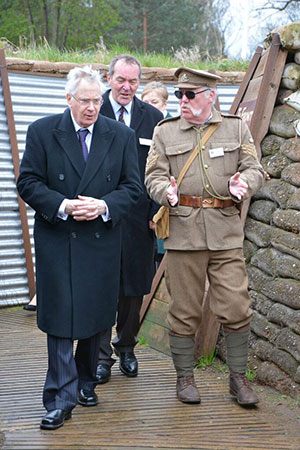 A re-enactor shows the Duke of Gloucester the recreated trench system