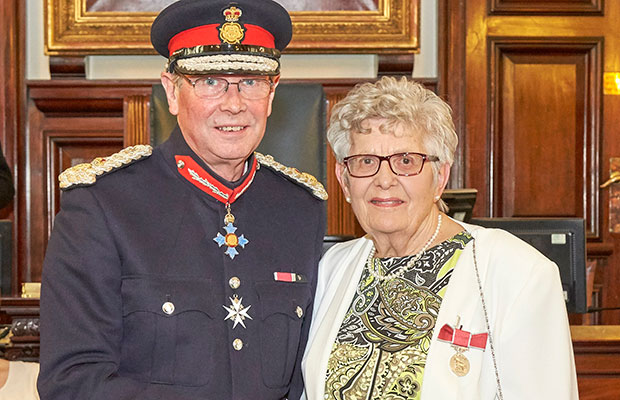 Veronica Box receives her British Empire Medal from the Lord-Lieutenant, Ian Dudson CBE CStJ