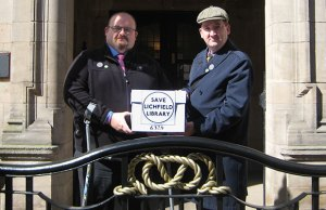 Lichfield and Burntwood Green Party members Adam Elsdon and Simon Partridge handing in the Save Lichfield Library petition at the County Buildings in Stafford