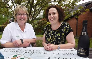 Lesley Holmes from St Giles Hospice with lottery winner Jo Bayliss