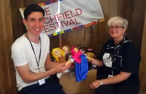 Rory Payne handing over ragdolls to Jenny Crosby from The Children's Society