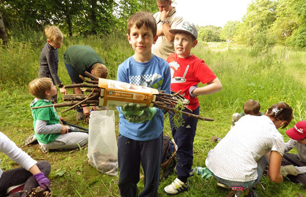 Scouts building a bug hotel on the route of the Lichfield Canal