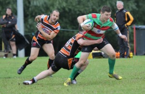 Burntwood's Ben Holt tries to burst through a tackle. Pic: Joanne Gough
