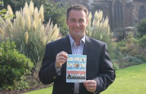 Cllr Iain Eadie with one of the new blue bin stickers