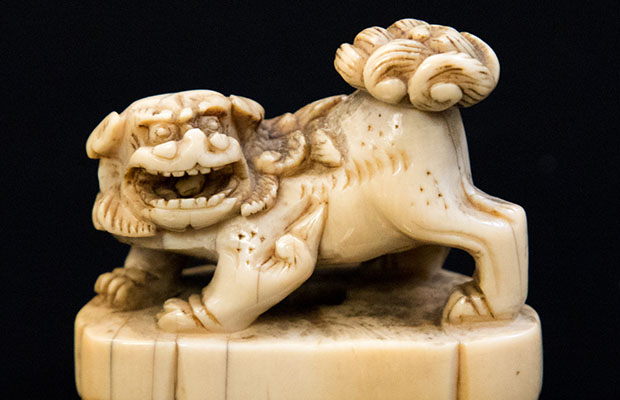 An 18th Century miniature ivory Foo dog on a plinth which sold for £350 at auction