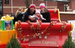 A family aboard the sleigh at the Three Spires Shopping Centre