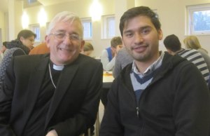 The Bishop of Lichfield Dr Michael Ipgrave with an Afghan citizen at Cafe Mittenmang