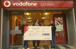 The cheque is presented outside the Lichfield branch of Vodafone