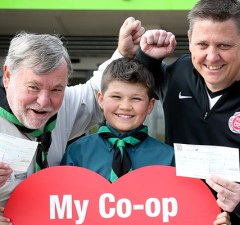 Representatives from 1st Lichfield St Chad's Scout Group and Whittington Junior Football Club celebrate their windfall from Central England Co-operative's Community Dividend Fund