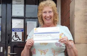 Cllr Heather Tranter with the cheque from the We Love Lichfield Fund