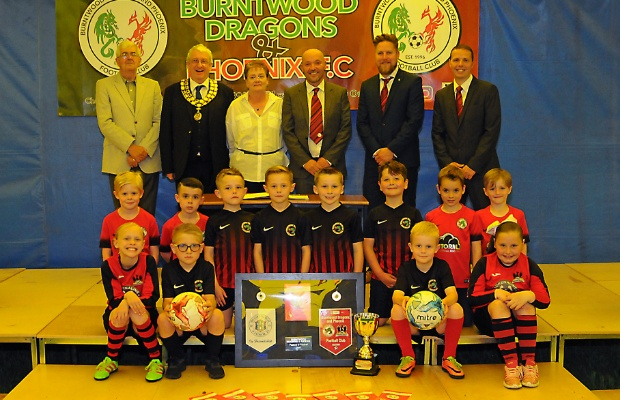 Councillors, club officials and players celebrate the new Coppy Nook lease