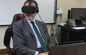 Christopher Pincher wearing the VR headset during his visit to St Giles Hospice
