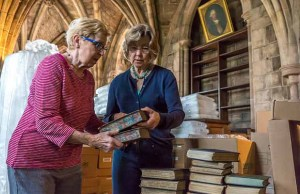 Volunteers packing up books in Lichfield Cathedral's library