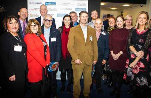 Representatives from the businesses that helped provide pantomime tickets for local families