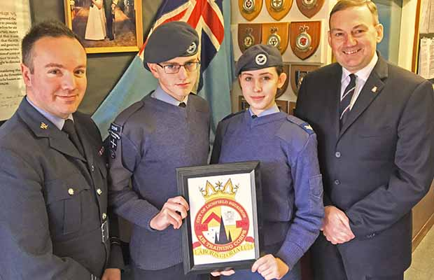 Flt Lt Chris Kelly, cadet Luke Lambert-Dean, cadet corporal Chloe Wright and squadron chairman Tony Davis