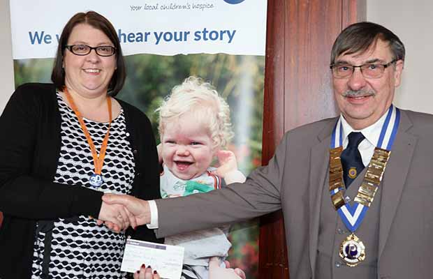 Ken Marshall hands over the cheque to Carol Pratt from Acorns Hospice
