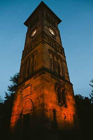 Lichfield Clock Tower lit up by West Midlands Railway