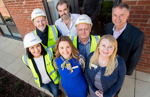 Sarah Sanderson, Ged Rodgers, Simon Price, Chris Backhouse, Carrie Jahn, Lisa Downes and Julian Fisher celebrate the donation to We Love Lichfield