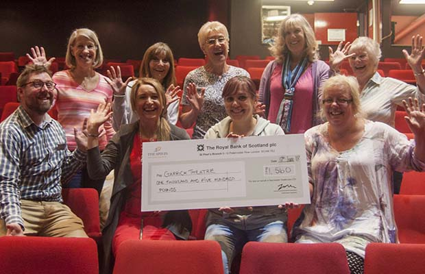The cheque is handed over at the Lichfield Garrick