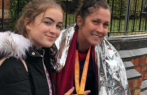 Jayne Whitehouse with her daughter Faith after completing the last race in her marathon challenge