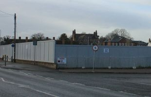 The boarded up former Tempest Ford site