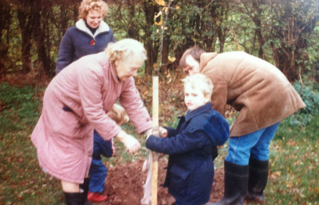 Bob Harrison and his family planting their tree in 1986