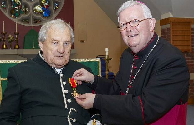 Noel Sweeney receiving the Order of St Gregory