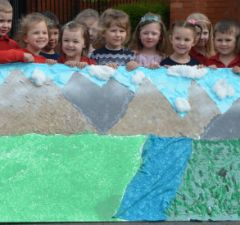 Children with their Everest mural created for Karen Mackay and Yvonne Smillie
