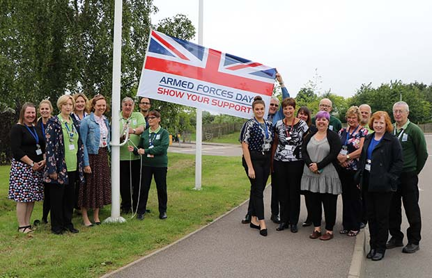 The Armed Forces Day flag being raised at the National Memorial Arboretum